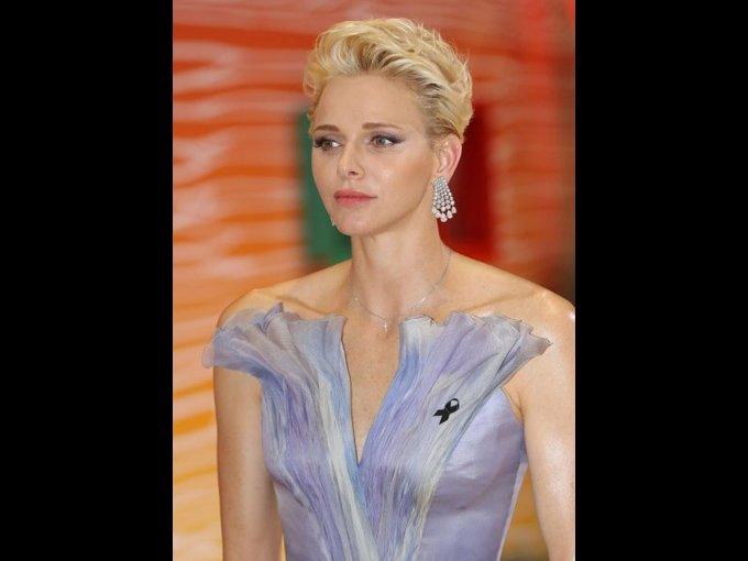 Charlene Lynette Wittstock. Exnadadora sudafricana campeona en los Juegos Olímpicos Sidney 2000. Ese año conoció al Príncipe Alberto de Mónado con quien más tarde se casó.